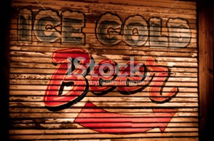 stock-photo-13823849-ice-cold-beer-sign-on-wooded-side-of-building